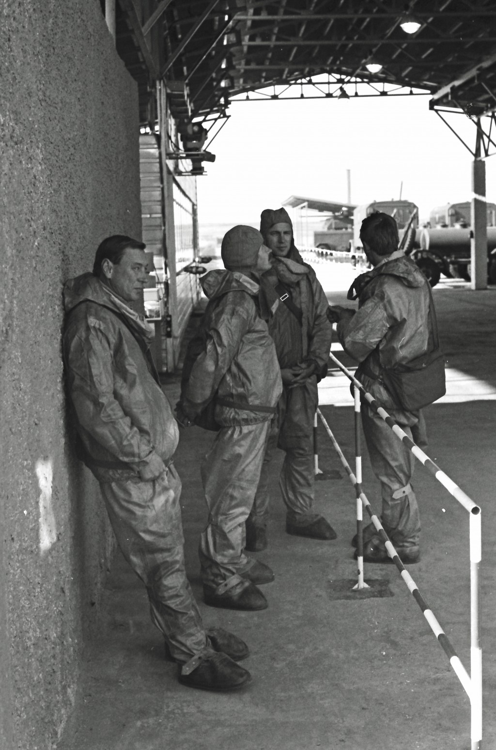 In this photo taken on Oct. 4, 1987, Soviet troops in protective gear take a break during a visit by Western diplomats and journalists to a chemical w...