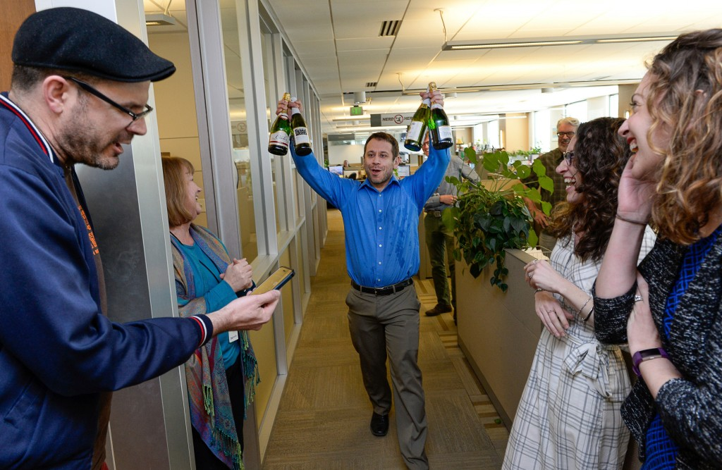 FILE - In this April 10, 2017, file photo, the Salt Lake Tribune Editor Matt Canham breaks out the champagne after their 2017 Pulitzer Prize for local...