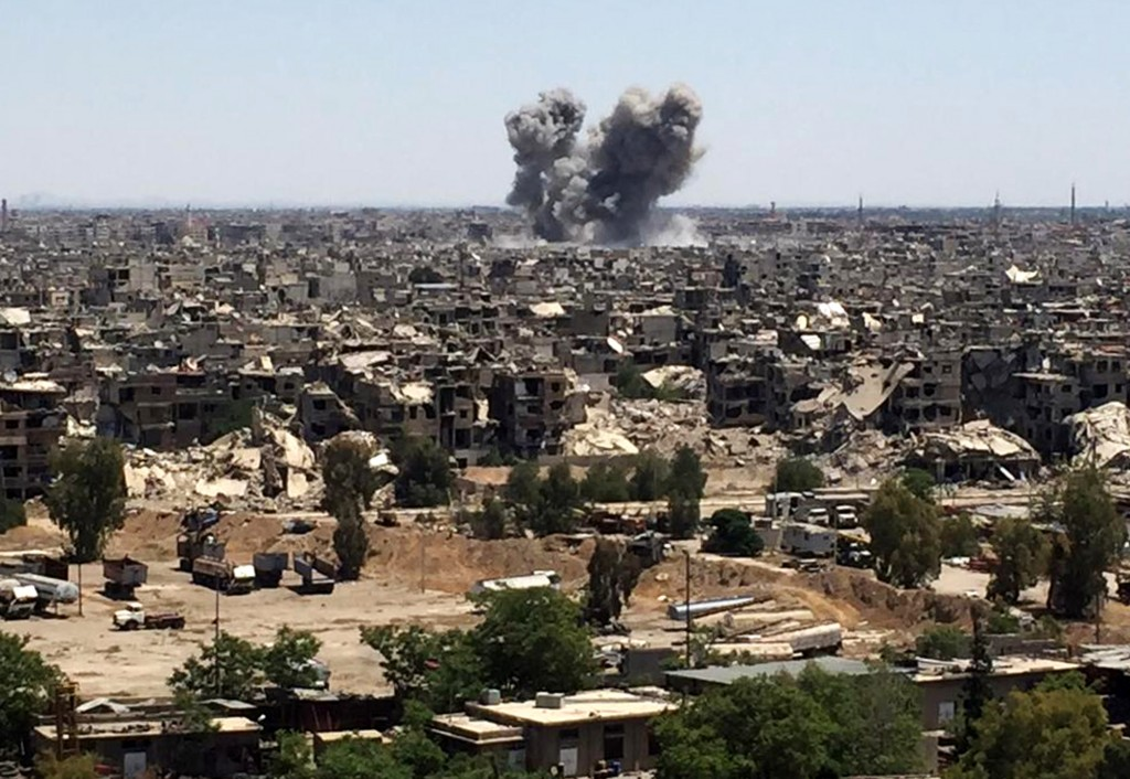 Smoke rises after Syrian government airstrikes and shelling hit in Hajar al-Aswad neighborhood held by Islamic State militants, southern Damascus, Syr...
