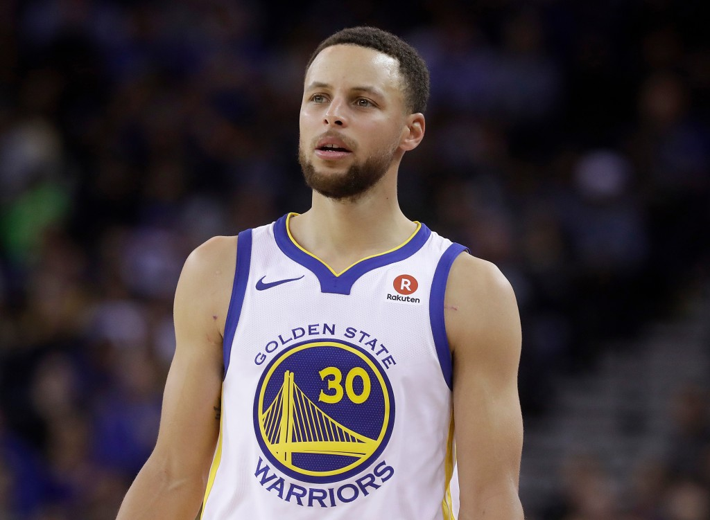 FILE - This March 6, 2018 file photo shows Golden State Warriors guard Stephen Curry during an NBA basketball game against the Brooklyn Nets in Oaklan...