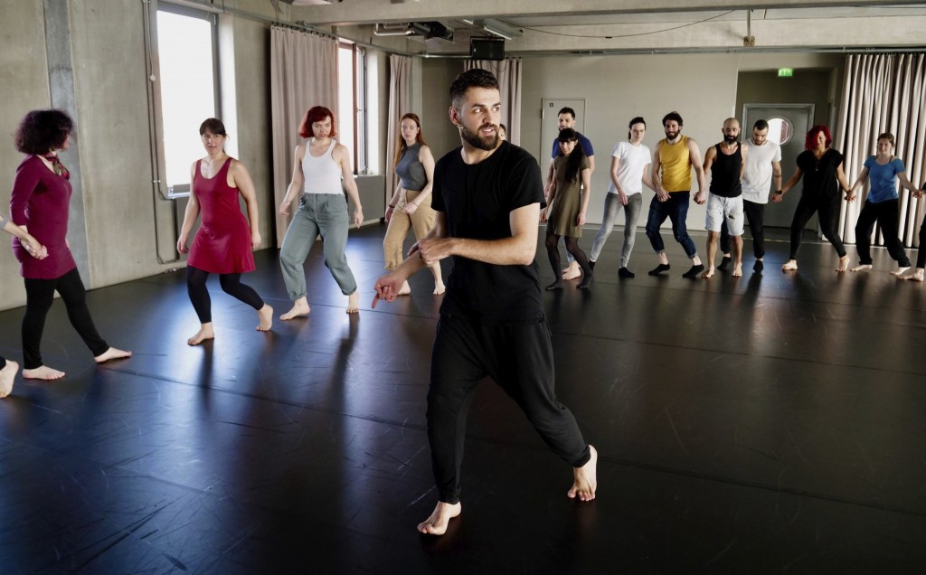 In this Sunday, April 15, 2018 photo Medhat Aldaabal, a Syrian migrant from Damascus, shows dance moves at a workshop to learn the traditional Arab da...