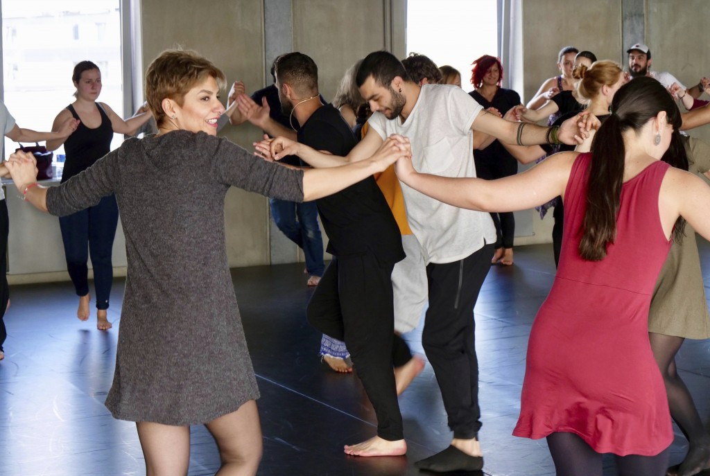 In this Sunday, April 15, 2018 photo a group of people take  part in a workshop, led by Syrian migrants, to learn the traditional Arabic dance Dabke i...