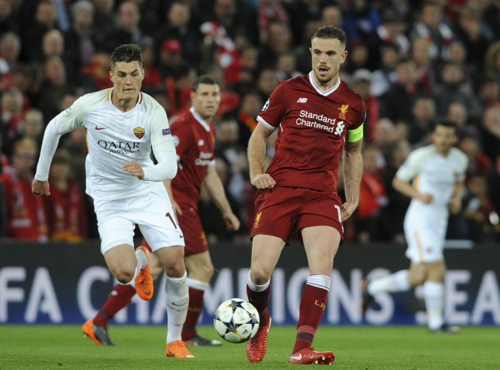 Liverpool's Jordan Henderson, right, duels for the ball with Roma's Patrik Schick during the Champions League semifinal, first leg, soccer match betwe...