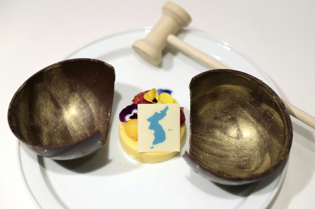 This undated photo provided by South Korea Presidential Blue House Tuesday, April 24, 2018, shows mango mousse decorated by a blue flag symbolizing a ...