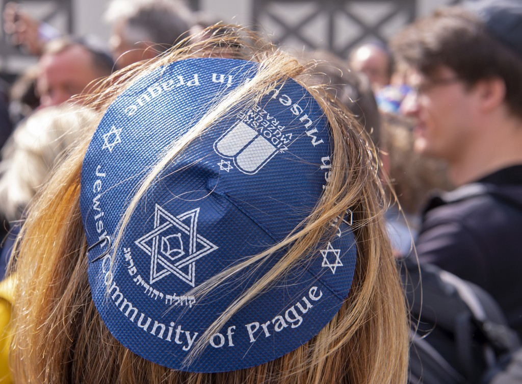 People of different faiths wear the Jewish kippah  during a demonstration against antisemitism in Germany in Erfurt, Germany, Wednesday, April 25, 201...