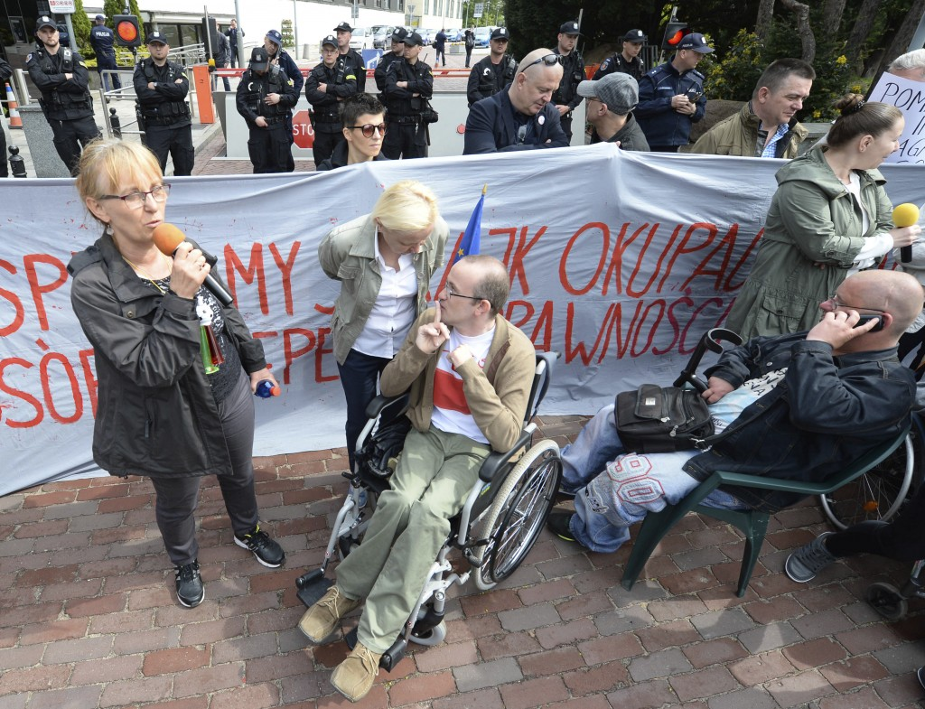 Parents of disabled adults picket in front of the parliament building to demand higher allowances for the care for their children and to protest gover...