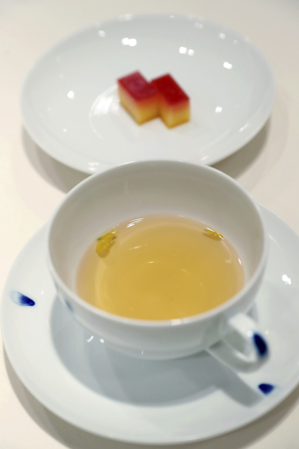 This undated photo provided by South Korea Presidential Blue House on Tuesday, April 24, 2018, shows tea and desserts made from citrus from South Kore...