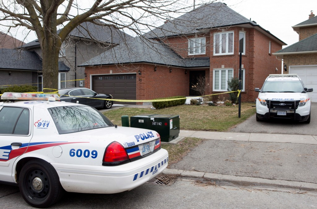 Police cars remain parked outside of of the Toronto area home of Alek Minassian in Richmond Hill, Ont., on Tuesday, April 24, 2018. Minassian, accused...