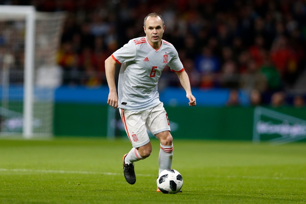 FILE - In this Tuesday, March 27, 2018 file photo, Spain's Andres Iniesta plays the ball during the international friendly soccer match between Spain ...