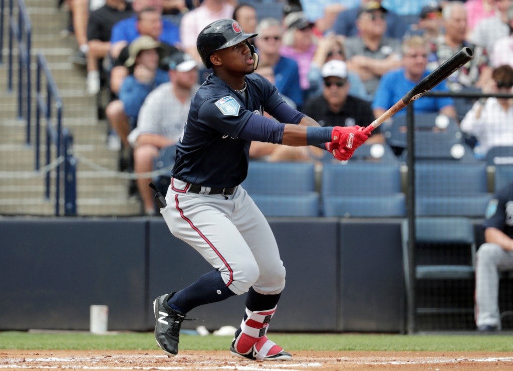 FILE - In this Friday, March 2, 2018, file photo, Atlanta Braves' Ronald Acuna watches after hitting a two-run home run during the first inning of a b...