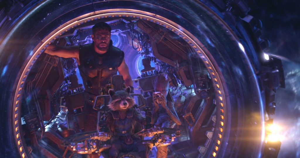 This image released by Marvel Studios shows Chris Hemsworth as Thor. with characters Rocket, voiced by Bradley Cooper, seated center, and Groot, voice...