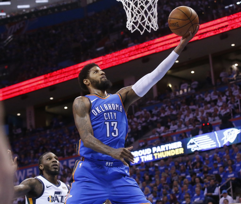 Oklahoma City Thunder forward Paul George (13) shoots in front of Utah Jazz forward Jae Crowder, left, during the first half of Game 5 of an NBA baske...