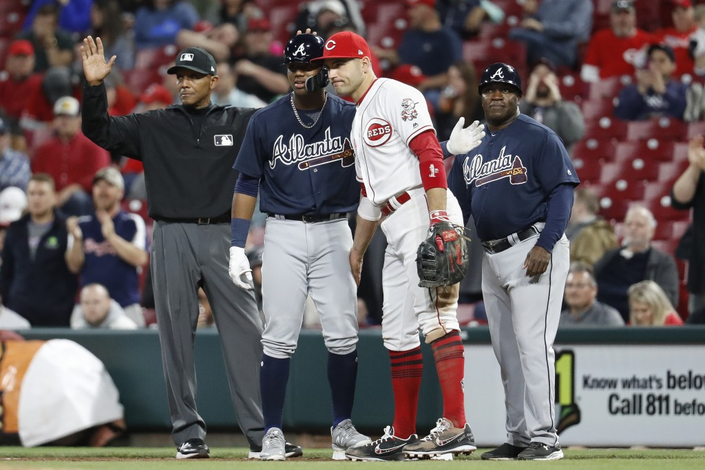 Atlanta Braves' Ronald Acuna Jr., center left, is congratulated by Cincinnati Reds first baseman Joey Votto, center right, after Acuna recorded his fi...