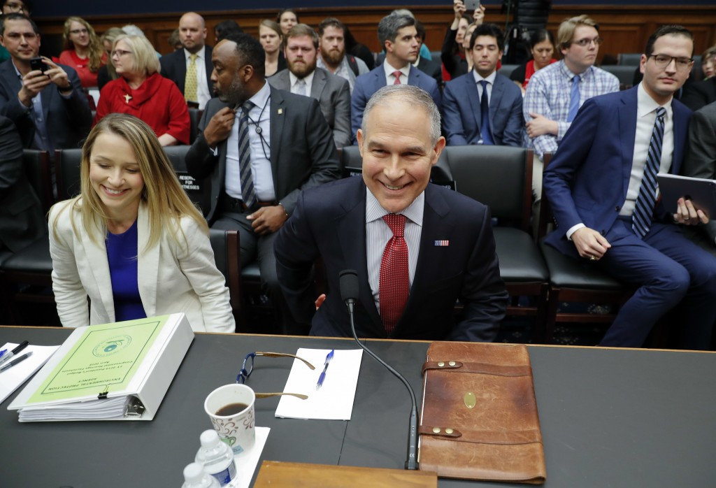 Environmental Protection Agency Administrator Scott Pruitt takes his seat as he arrives to testify before the House Energy and Commerce subcommittee h...