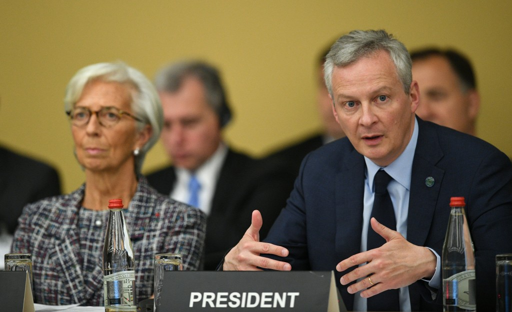 """International Monetary Fund (IMF) managing director Christine Lagarde, left, listens as French Economy Minister Bruno Le Maire speaks during the """"No m..."""