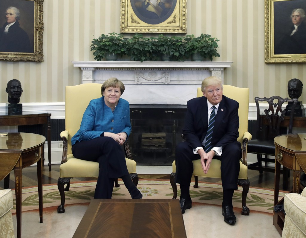 FILE - In this March 17, 2017 file photo President Donald Trump and German Chancellor Angela Merkel meet in the Oval Office of the White House in Wash...