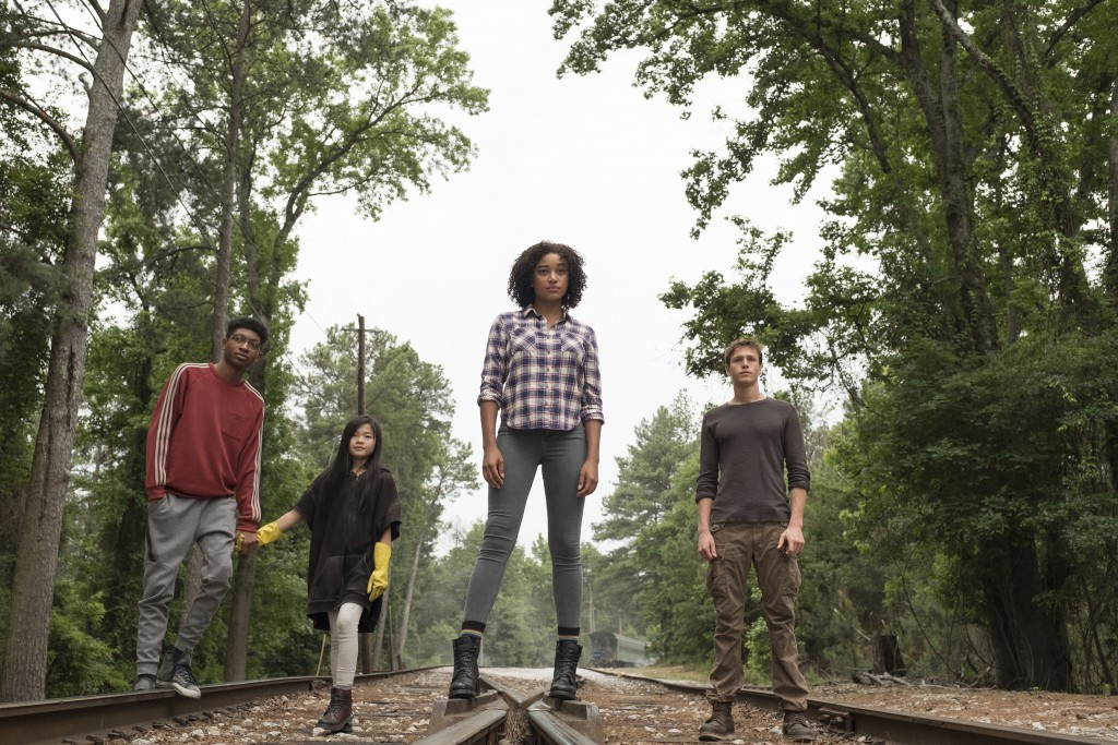 """This image released by 20th Century Fox shows, from left, Skylan Brooks, Miya Cech, Amandla Stenberg and Harris Dickinson in a scene from, """"The Darkes..."""
