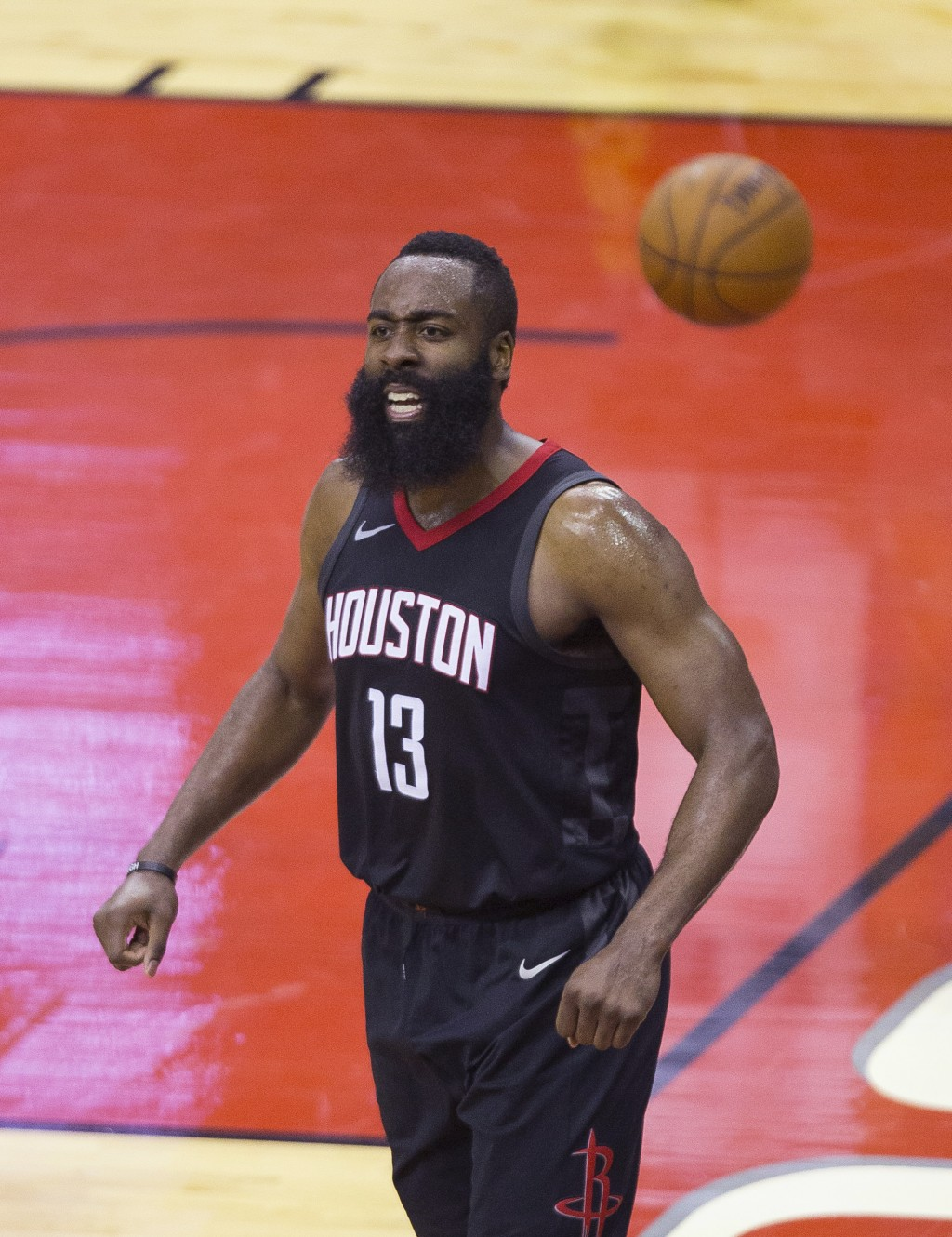 Houston Rockets guard James Harden (13) celebrates after a drawing a foul against the Minnesota Timberwolves on a dunk during Game 5 of an NBA basketb...