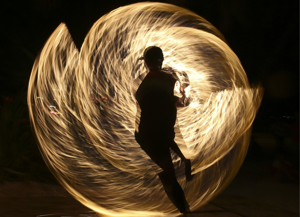 In this Wednesday, April 25, 2018, file photo, a Filipino fire dancer performs for the last time a day before the government implements the temporary ...