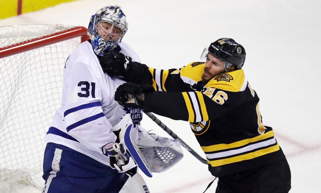 Boston Bruins center David Krejci (46) checks Toronto Maple Leafs goaltender Frederik Andersen (31) during the second period of Game 7 of an NHL hocke...