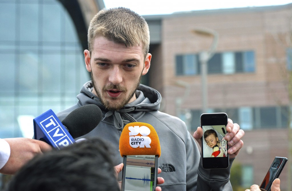 Tom Evans holds up his phone showing a photo of his son Alfie as he speaks to the media outside Alder Hey Children's Hospital where the 23-month-old w...