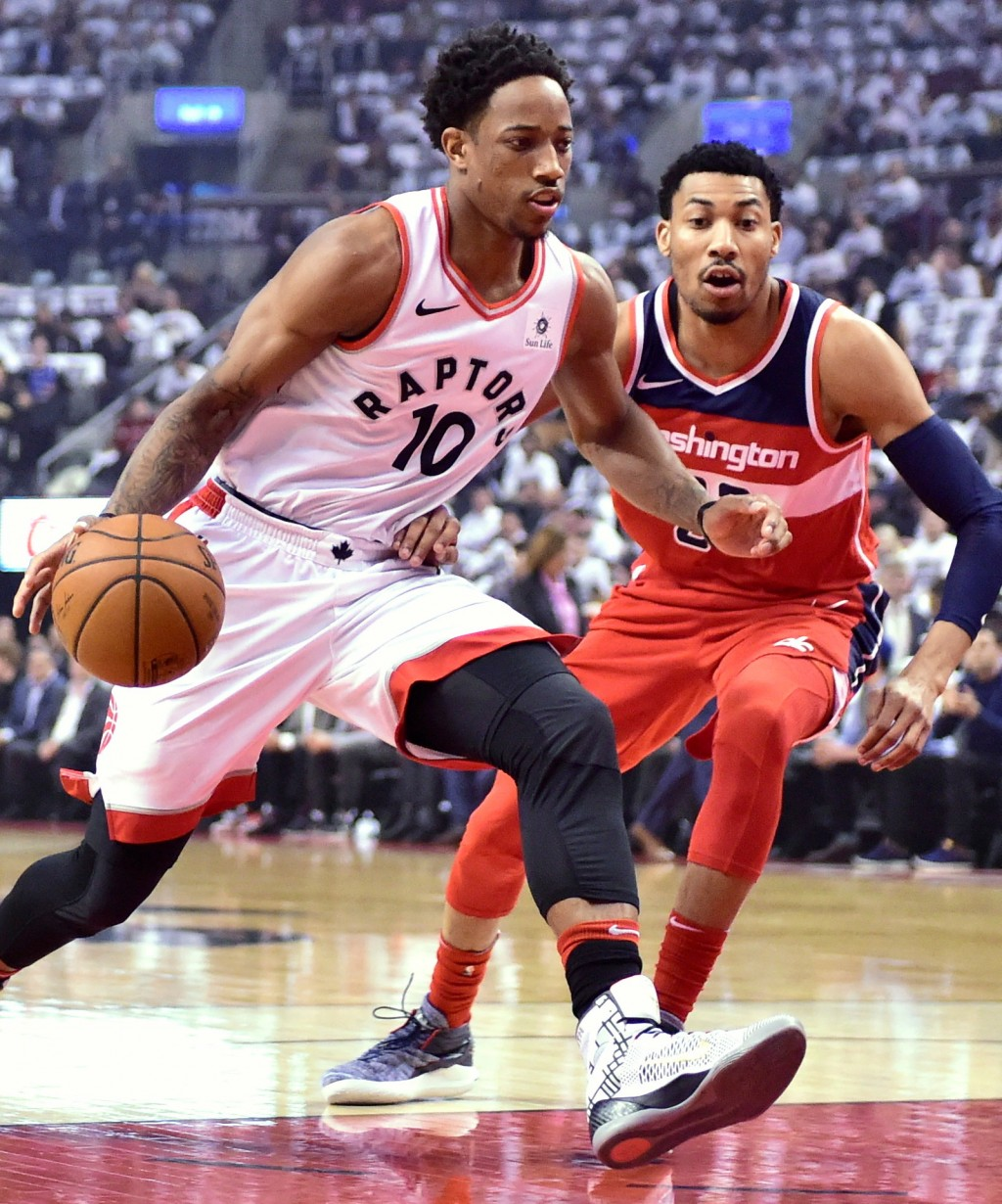 Toronto Raptors' DeMar DeRozan drives against Washington Wizards Otto Porter Jr. during the first half of Game 5 of an NBA basketball first-round play...