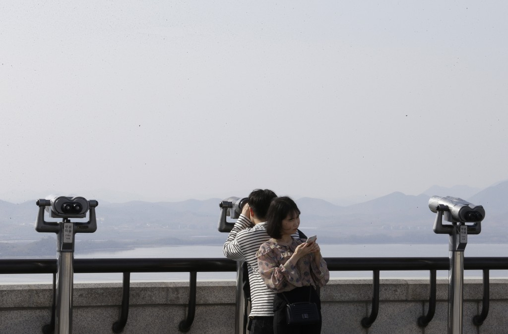 A man watches the North side from the unification observatory in Paju, near the border with North Korea, South Korea, Thursday, April 26, 2018. North ...