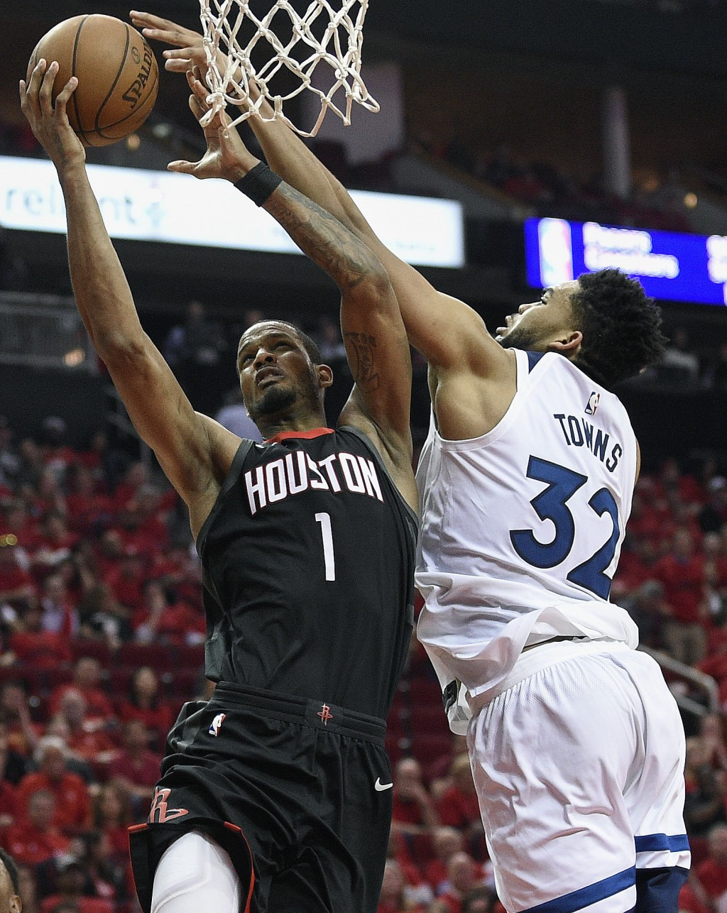 Minnesota Timberwolves center Karl-Anthony Towns, right, blocks the shot of Houston Rockets forward Trevor Ariza during the second half in Game 5 of a...