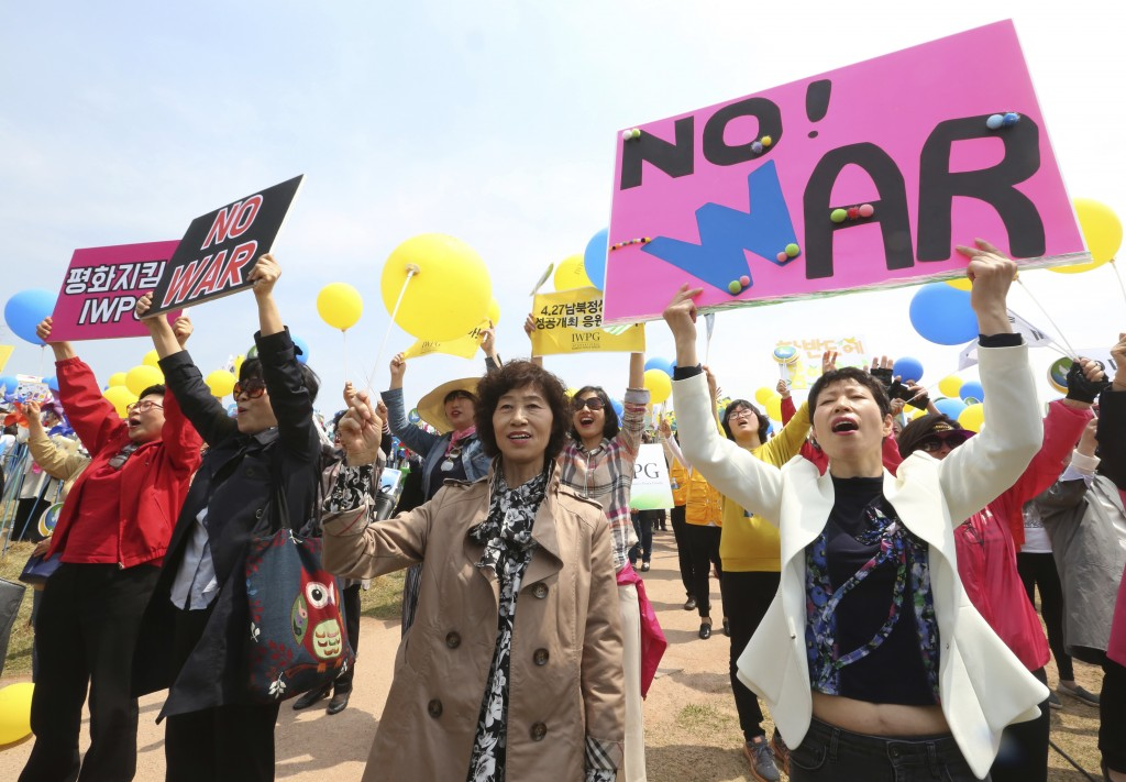Members of the South Korean women's peace group stage a rally to support the upcoming summit between South and North Korea at the Imjingak Pavilion in...