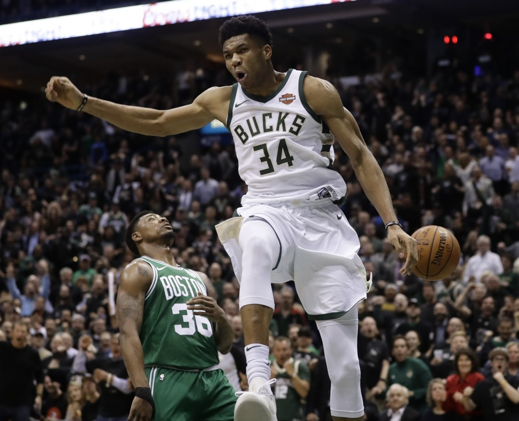Milwaukee Bucks' Giannis Antetokounmpo reacts after a dunk during the first half of Game 6 of an NBA basketball first-round playoff series against the...