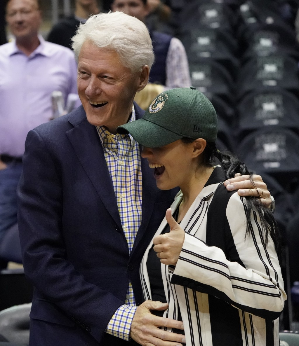 Former President Bill Clinton poses for picture before Game 6 of an NBA basketball first-round playoff series between the Milwaukee Bucks and the Bost...