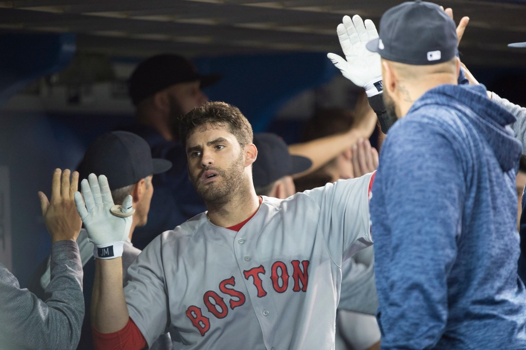 Boston Red Sox's J.D. Martinez reacts after hitting a three-run home run against the Toronto Blue Jays during the fifth inning of a baseball game in T...