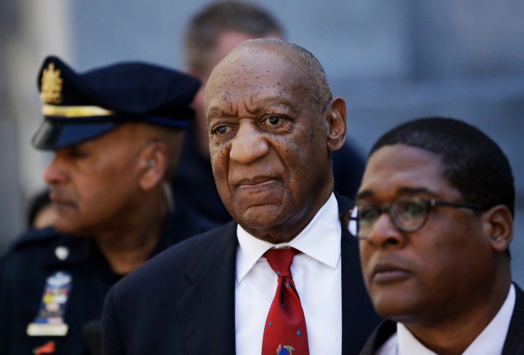 Bill Cosby, center, leaves the the Montgomery County Courthouse after being convicted of drugging and molesting a woman, Thursday, April 26, 2018, in ...