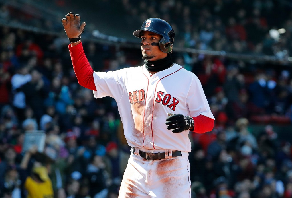 FILE - In this April 7, 2018, file photo, Boston Red Sox's Xander Bogaerts heads for the dugout after scoring against the Tampa Bay Rays during the fi...