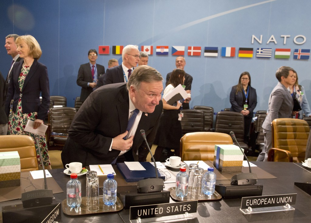 U.S. Secretary of State Mike Pompeo, center, takes his seat during a meeting of the North Atlantic Council at NATO headquarters in Brussels on Friday,...