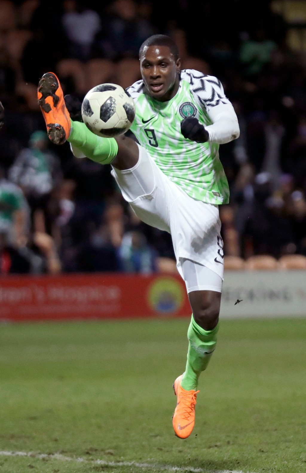 In this photo taken on Tuesday, March 27, 2018, Nigeria's Odion Ighalo reaches for the ball during the international friendly soccer match between Ser...