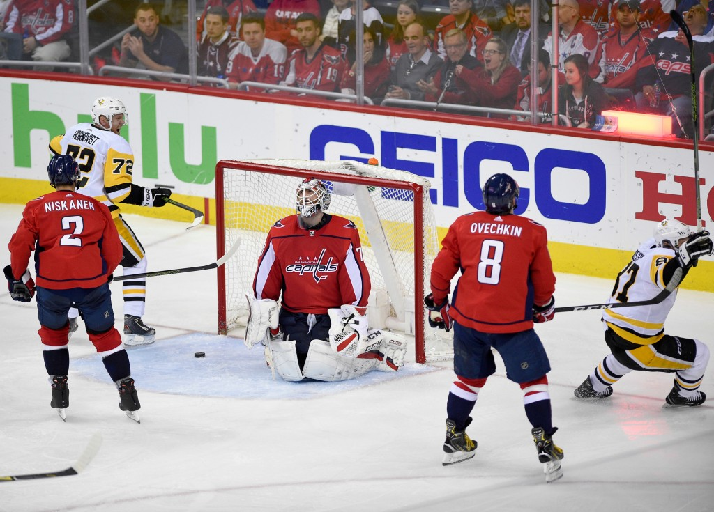 Washington Capitals goaltender Braden Holtby, center, reacts after a goal by Pittsburgh Penguins center Sidney Crosby, right, during the third period ...