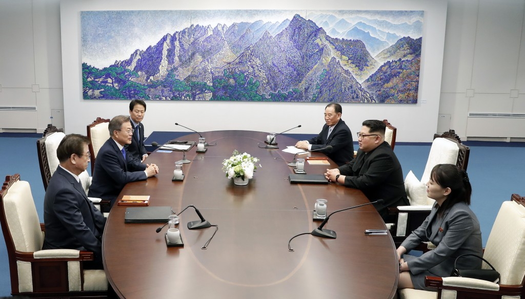North Korean leader Kim Jong Un, second from right, and South Korean President Moon Jae-in, second from left, attend during a summit at Peace House of...
