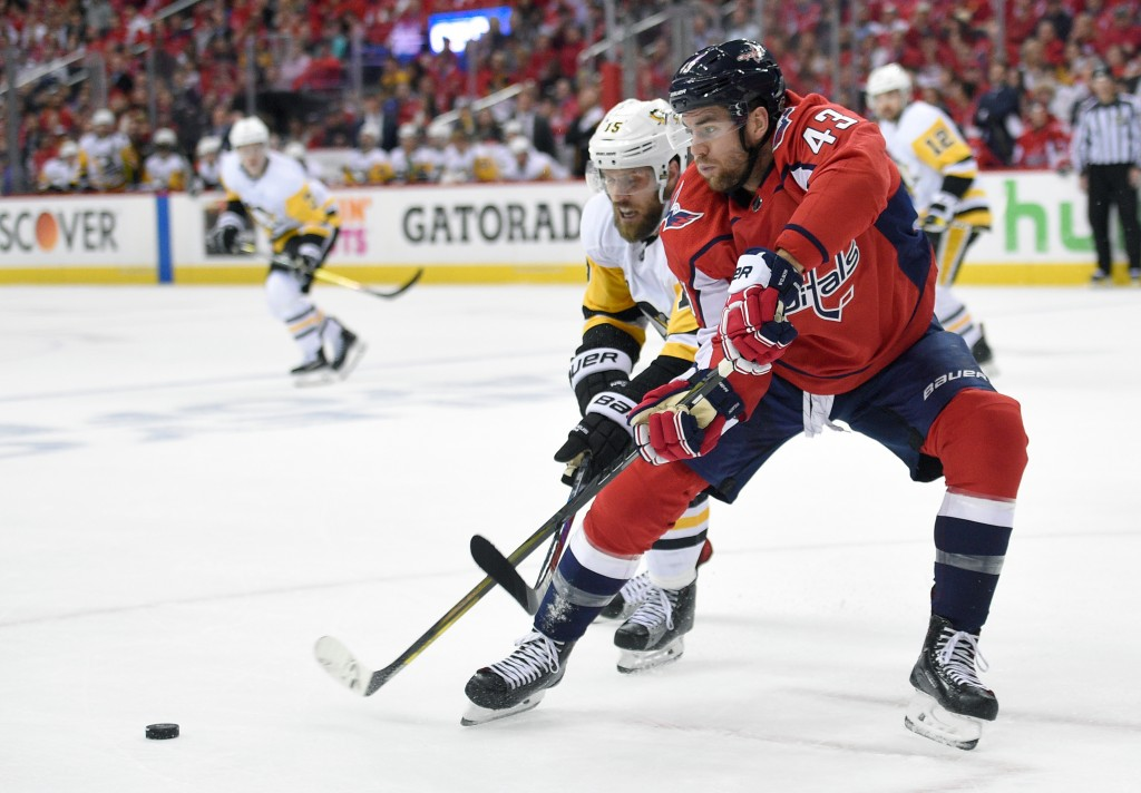 Pittsburgh Penguins center Riley Sheahan battles for the puck against Washington Capitals right wing Tom Wilson (43) during the first period in Game 1...