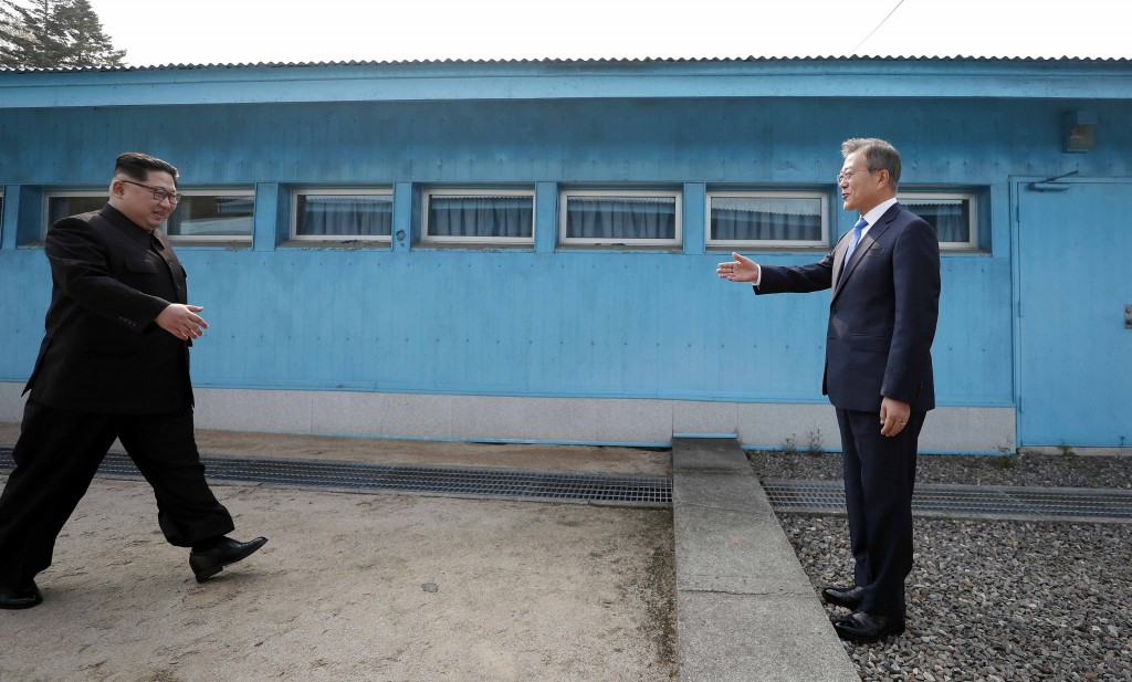 North Korean leader Kim Jong Un, left, walks to meet with South Korean President Moon Jae-in at the military demarcation line at the border village of...