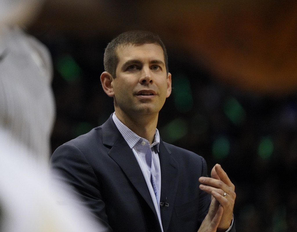 Boston Celtics head coach Brad Stevens claps during the first half of Game 6 of an NBA basketball first-round playoff series against the Milwaukee Buc...