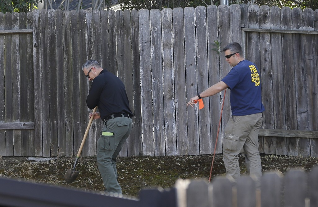 Authorities probe the backyard of the home of murder suspect Joseph DeAngelo, Thursday, April 26, 2018, in Citrus Heights, Calif. DeAngelo, 72, was ta...