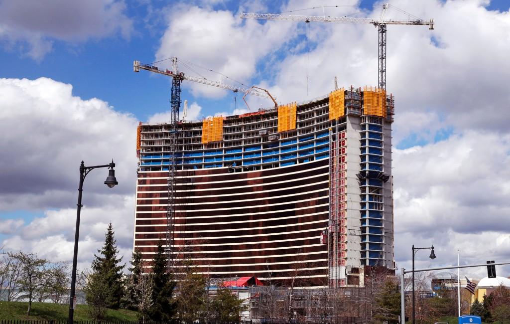 Construction cranes tower over the Wynn Resorts casino site in Everett, Mass., Thursday, April 26, 2018. Massachusetts gambling regulators consider Wy...