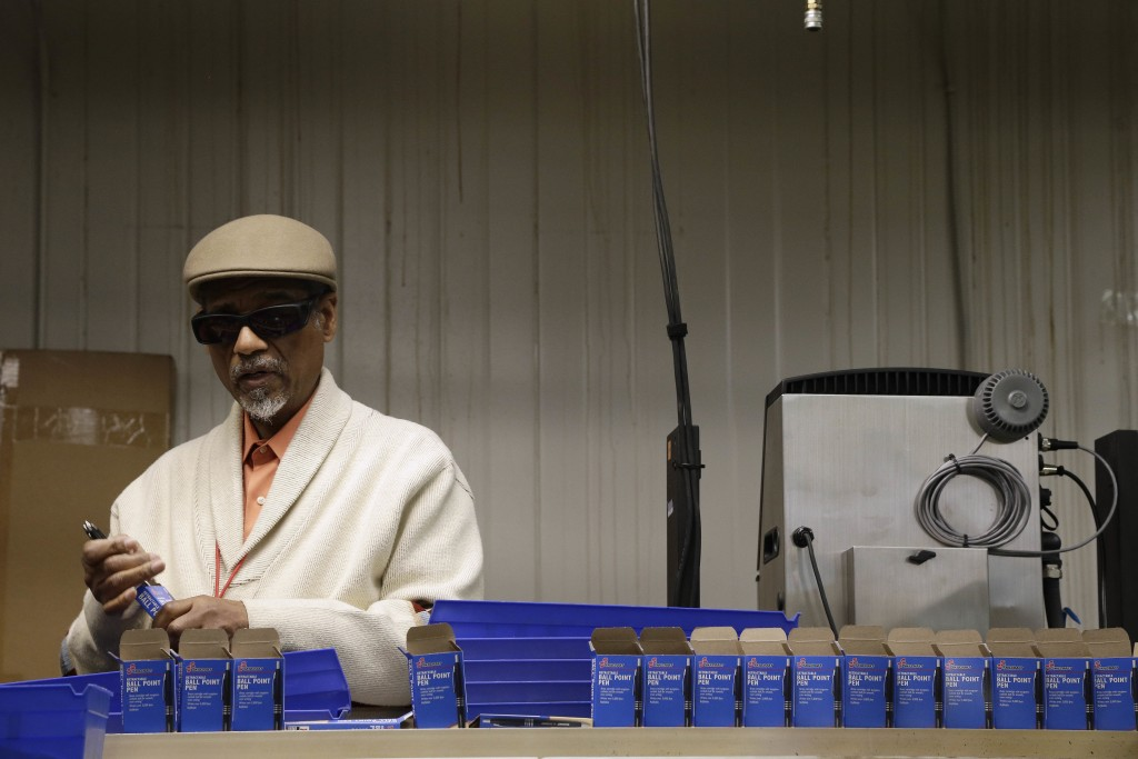 In this April 16, 2018, photo, employee Clifford Alexander Sr. boxes SKILCRAFT pens for the U.S. Government at the Industries of the Blind in Greensbo...