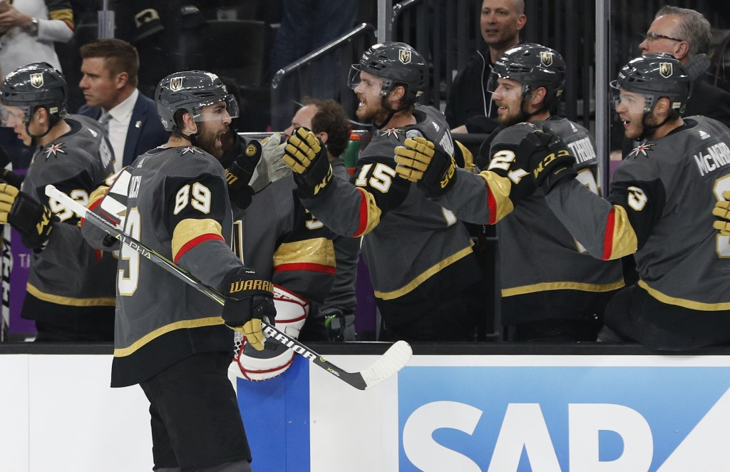 Vegas Golden Knights right wing Alex Tuch (89) celebrates after scoring against the San Jose Sharks during the first period of Game 1 of an NHL hockey...