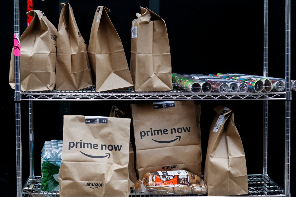 File- This Wednesday, Dec. 20, 2017, file photo, shows Amazon Prime Now bags are ready for delivery, at the Amazon warehouse in New York. Amazon says ...