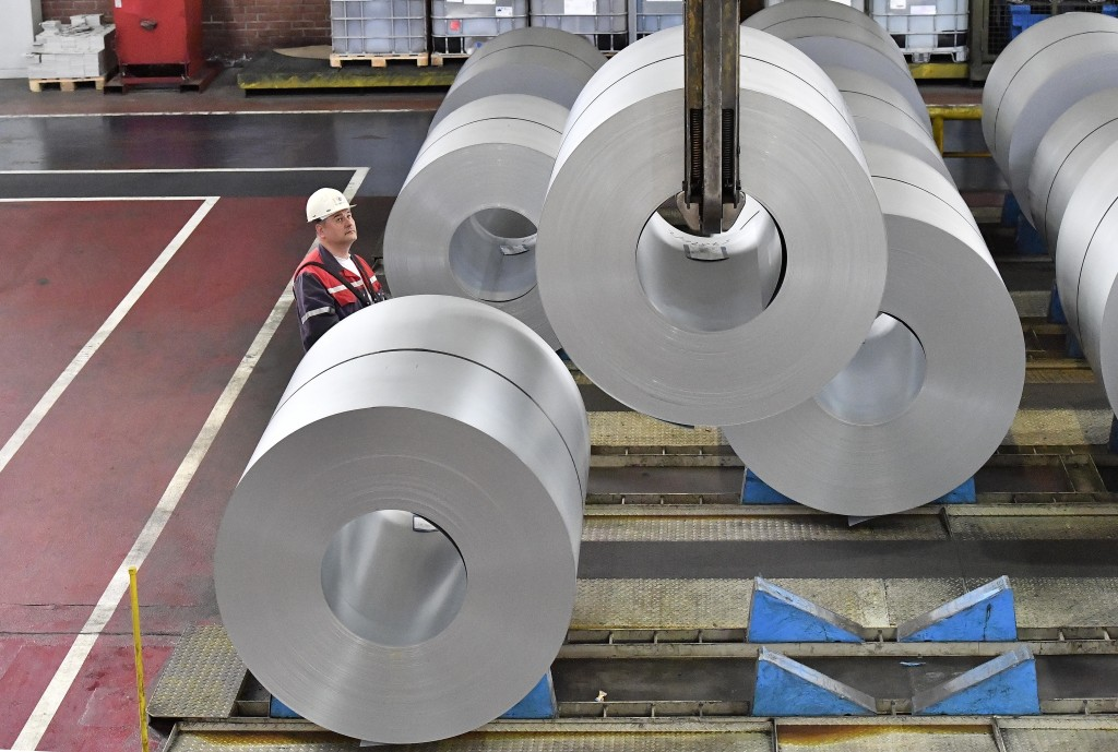 A worker moves steel coils at the Thyssenkrupp steel factory in Duisburg, Germany, Friday, April 27, 2018. Duisburg is the biggest steel producer site...