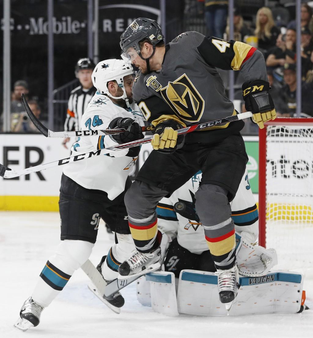 Vegas Golden Knights center Ryan Carpenter (40) jumps out of the way of a shot on San Jose Sharks goaltender Martin Jones (31) during the second perio...