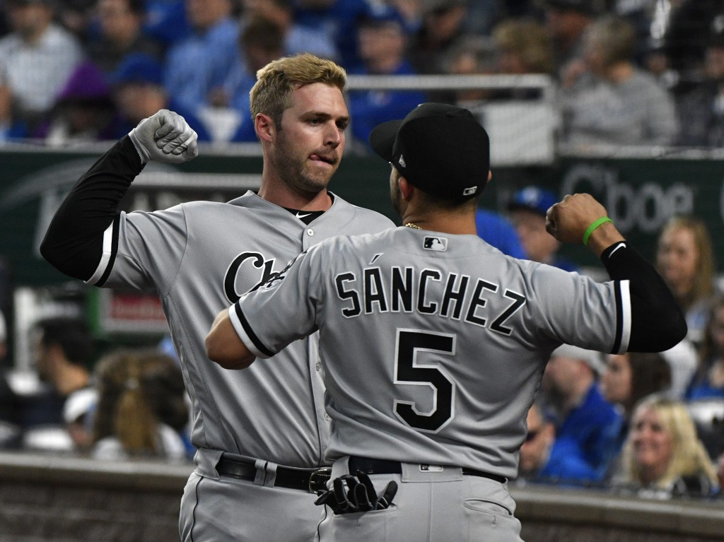 Chicago White Sox Matt Davidson, back, celebrates his home run with Yolmer Sanchez (5) during the fourth inning of the team's baseball game against th...