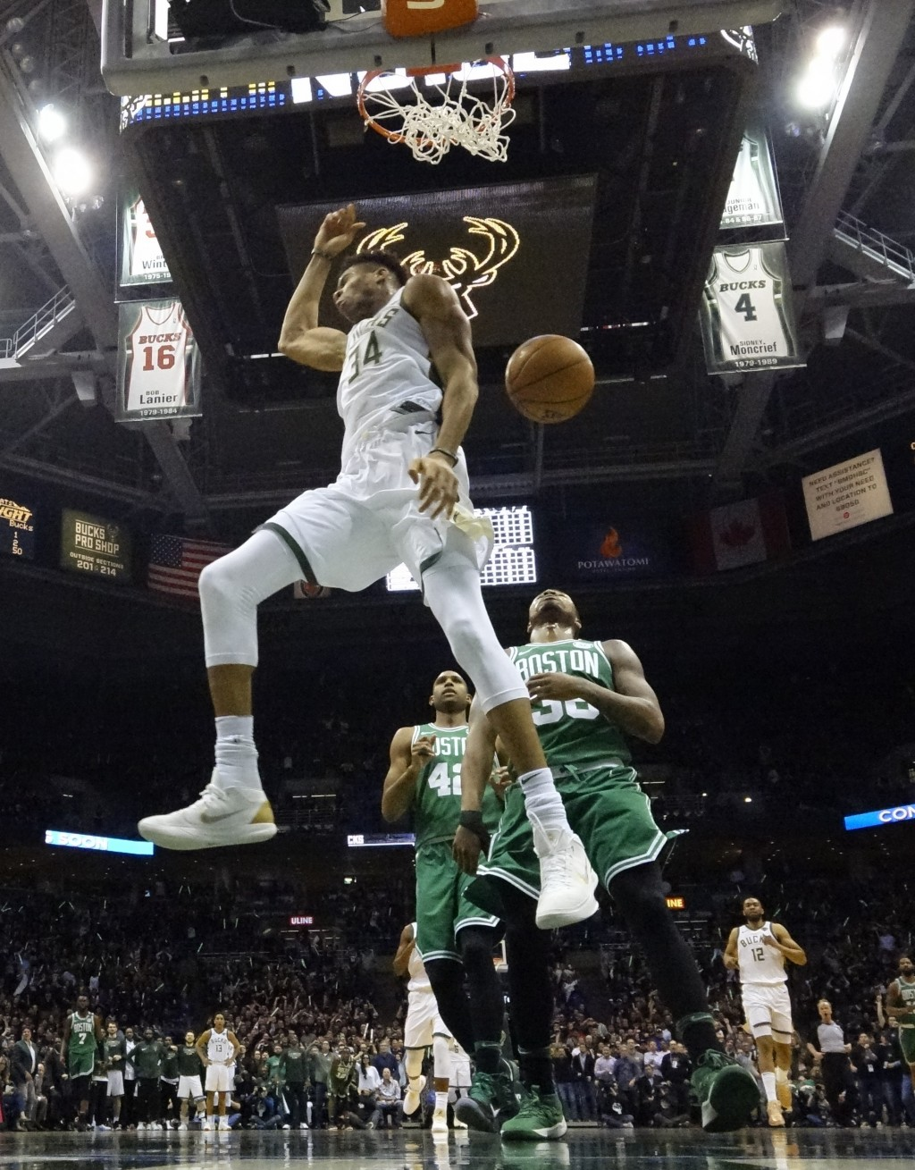 Milwaukee Bucks' Giannis Antetokounmpo dunks during the first half of Game 6 of an NBA basketball first-round playoff series against the Boston Celtic...